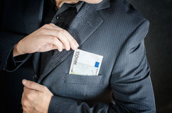 Money in packet. Man has enveloped euro banknotes Stock Photos