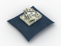 Money paks on pillow. Blue dotted pillow with paks of dollars on it Stock Photo