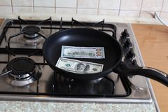 Money in a pan Stock Photography