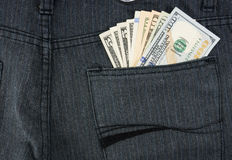 Money in pant pocket Stock Images