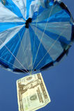 Money and parachute 1. Money floating down on a parachute stock photos