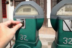 Money in Parking Meter Stock Image