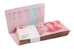 Money and passbook. Chinese passbook and rmb with white background Royalty Free Stock Images