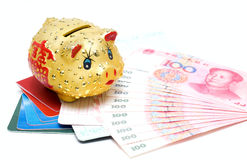 Money and passbook. Chinese piggy bank on the 100 yuan Renminbi and passbook Stock Photography