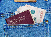 Money and passport in the back pocket. Of jeans Royalty Free Stock Photography
