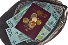 Money and passport in cap Royalty Free Stock Photography