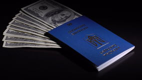 Money and passport on the table stock footage