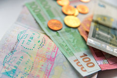 Money and passport with visa stamps Stock Images