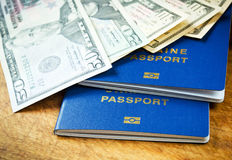 Money and passports for travel Stock Photography