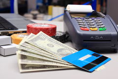 Money and payment terminal with credit card Stock Images