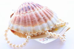 Money from pearls. Concept with luxury pearls and seashell and fifty euro Royalty Free Stock Photography