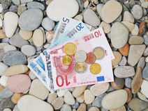 Money on a pebble beach Stock Photography
