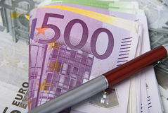 Money and pen. Lot of paper money euro banknotes and red pen Stock Photography