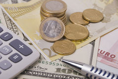 Money, pen and calculator Stock Images