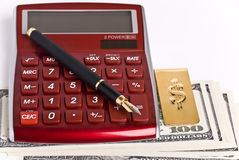 Money, pen and calculator Stock Image