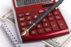 Money, pen and calculator Royalty Free Stock Photo