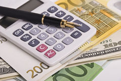 Money, pen and calculator Royalty Free Stock Photography