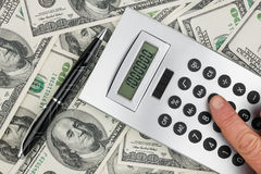 Money,pen and a calculator Royalty Free Stock Image
