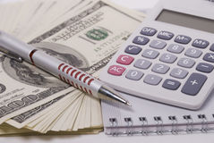 Money, pen and calculator Stock Photography