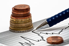 Money with pen on chart Royalty Free Stock Photography