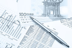 Money and pen on financial papers Stock Photography