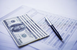 Money, pen and financial report Stock Images
