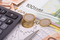 Money, pen. graph and calculator Stock Image