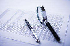 Money, pen, magnifying glass and the financial report Royalty Free Stock Images