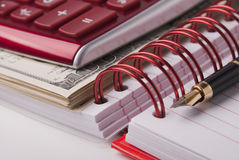 Money, pen, notebook and caculator Royalty Free Stock Photos