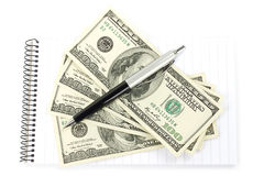 Money and pen with notepad Royalty Free Stock Images