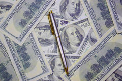Money and pen Stock Photo