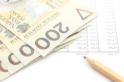 Money and pencil lying on spreadsheet Stock Photos