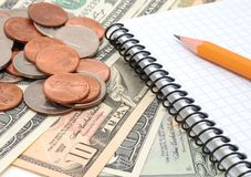 Money, pencil, notebook. Royalty Free Stock Images