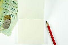 Money with pencil and paper Royalty Free Stock Photo