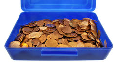 Money pennies and fortunately carp scales. In the blue box isolated Royalty Free Stock Photography