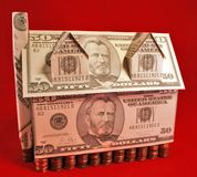 Money Penny. A house of money supported by pennies royalty free stock images