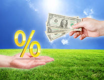 Money and percentage symbol in hands Stock Photography