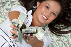 Money Person. Smiling person laying in money Stock Photos