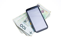 Money for phone. Cellphone and lots of Polish money Stock Photography