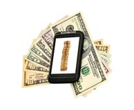 Money and phone. Money and mobile  phone on a white background Royalty Free Stock Images
