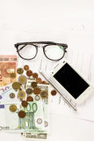 Money phone calculator pen paper and glasses on white background Royalty Free Stock Images