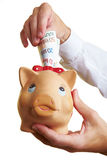Money in a piggy bank Royalty Free Stock Photography