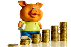 Money with piggy bank  on white. Money (euro) with arrow and piggy bank  on white background Stock Images
