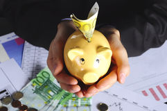 Money in piggybank Royalty Free Stock Photos