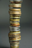 Stack of coins. Tall stack of coins from different countries Stock Photo