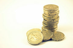 Money. Pile or stack of UK 1 pound coins Royalty Free Stock Photos