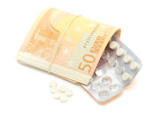 Money & pill Stock Image