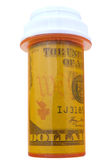 Money in pill bottle Royalty Free Stock Photos