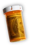 Money in a Pill Bottle. An isolated pill bottle is filled with a $100 dollar bill (USD Stock Images