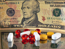 Money and Pills. Concept with American dollars and pills Royalty Free Stock Images